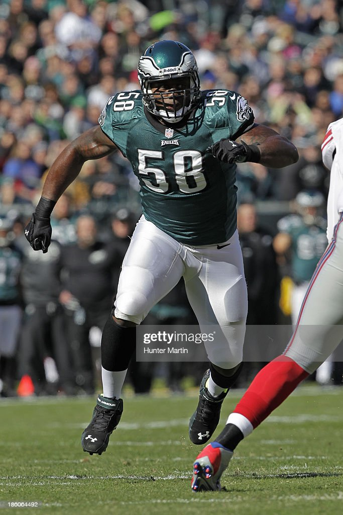 <a gi-track='captionPersonalityLinkClicked' href=/galleries/search?phrase=Trent+Cole&family=editorial&specificpeople=763574 ng-click='$event.stopPropagation()'>Trent Cole</a> #58 of the Philadelphia Eagles rushes the quarterback during a game against the New York Giants on October 27, 2013 at Lincoln Financial Field in Philadelphia, Pennsylvania. The Giants won 15-7.