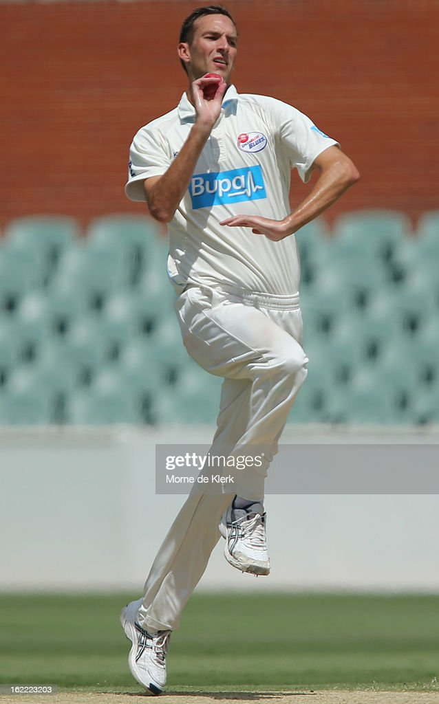 Trent Copeland of the Blues bowls during day three of the Sheffield Shield match between the South Australian Redbacks and the New South Wales Blues at Adelaide Oval on February 21, 2013 in Adelaide, Australia.