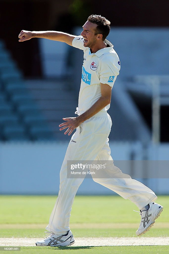 Trent Copeland of the Blues celebrates after getting a wicket during day one of the Sheffield Shield match between the South Australian Redbacks and the New South Wales Blues at Adelaide Oval on February 19, 2013 in Adelaide, Australia.