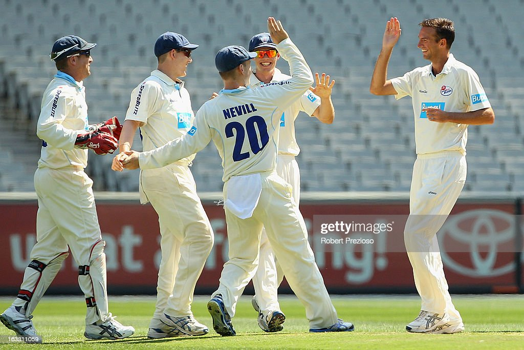Trent Copeland of the Blues celebrates the wicket of Chris Rogers of the Bushrangers during day two of the Sheffield Shield match between the Victorian Bushrangers and the New South Wales Blues at Melbourne Cricket Ground on March 8, 2013 in Melbourne, Australia.