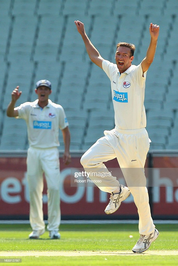 Trent Copeland of the Blues celebrates the wicket of Rob Quiney of the Bushrangers during day two of the Sheffield Shield match between the Victorian Bushrangers and the New South Wales Blues at Melbourne Cricket Ground on March 8, 2013 in Melbourne, Australia.