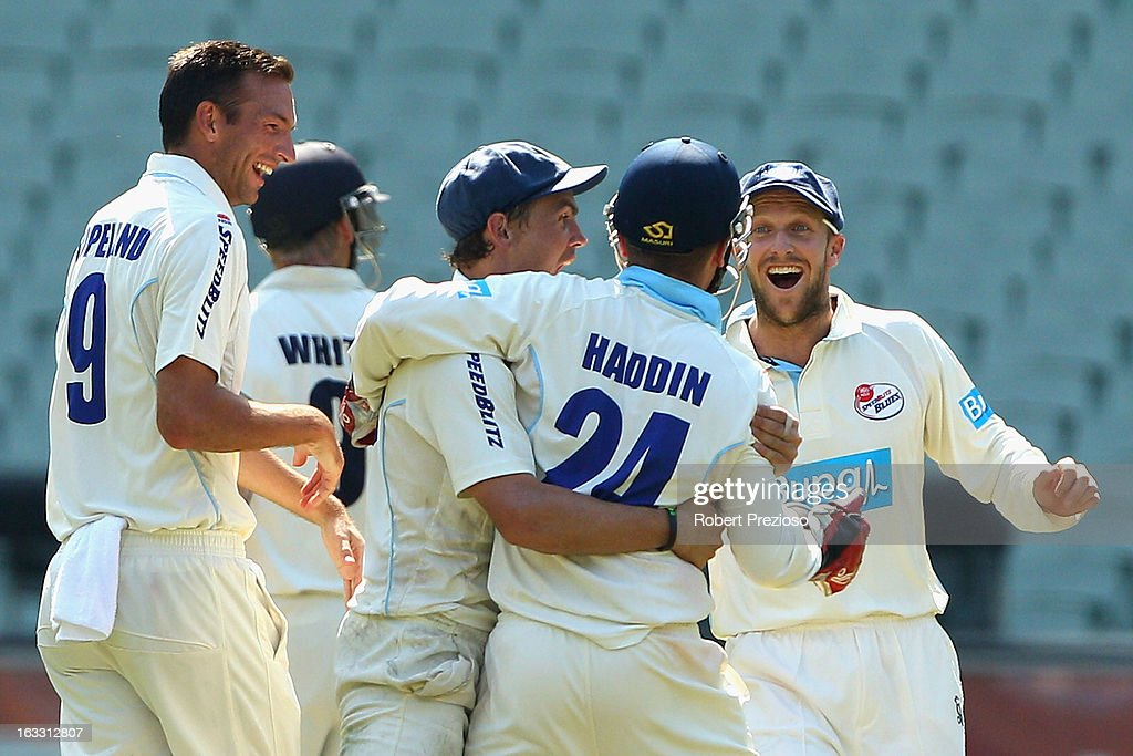 Trent Copeland of the Blues celebrates the wicket of Rob Quiney of the Bushrangers stumped by <a gi-track='captionPersonalityLinkClicked' href=/galleries/search?phrase=Brad+Haddin&family=editorial&specificpeople=193800 ng-click='$event.stopPropagation()'>Brad Haddin</a> of th Blues during day two of the Sheffield Shield match between the Victorian Bushrangers and the New South Wales Blues at Melbourne Cricket Ground on March 8, 2013 in Melbourne, Australia.