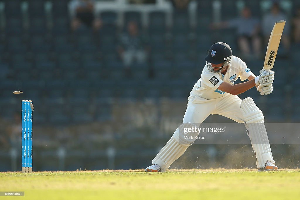Trent Copeland of the Blues is bowled during day three of the Sheffield Shield match between the New South Wales Blues and the Tasmania Tigers at Blacktown International Sportspark on November 1, 2013 in Sydney, Australia.