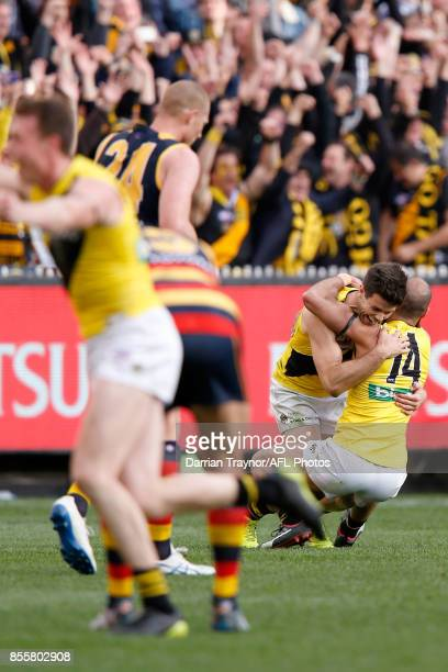 Trent Cotchin and Bachar Houli of the Tigers celebrate on the final siren during the 2017 AFL Grand Final match between the Adelaide Crows and the...