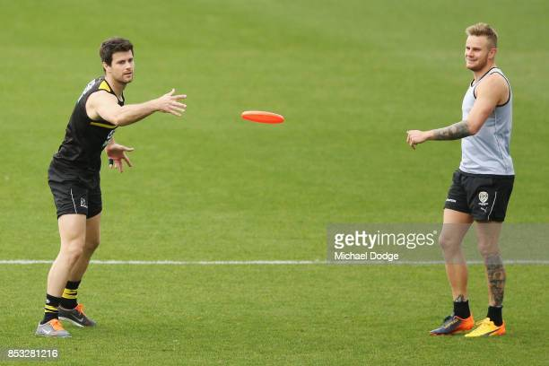 Trent Cotchin and Brandon Ellis of the Tigers play with a frisby during a Richmond Tigers AFL media oportunity at Punt Road Oval on September 25 2017...