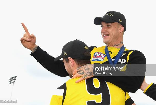 Trent Cotchin and Dustin Martin of the Tigers celebrate on stage after winning yesterday's AFL Grand Final at Punt Road Oval on October 1 2017 in...