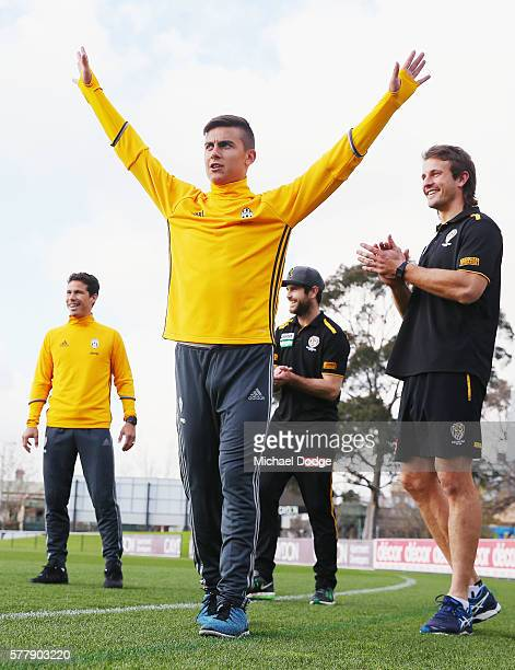 Trent Cotchin and Ivan Maric of the Tigers react with Hernanes as his teammate Paulo Dybala of Juventus celebrates kicking a goal during a Richmond...