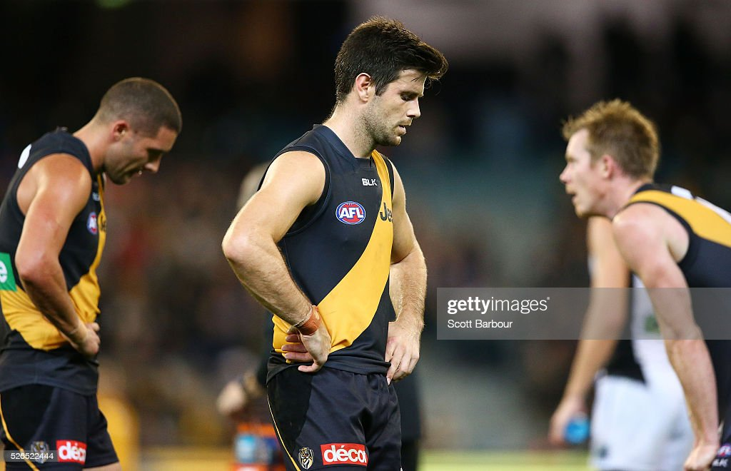 Trent Cotchin and Jack Riewoldt of the Tigers react at full time after losing the round six AFL match between the Richmond Tigers and the Port Adelaide Power at Melbourne Cricket Ground on April 30, 2016 in Melbourne, Australia.