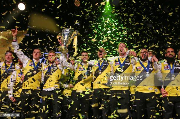Trent Cotchin and the Tigers celebrate with the AFL Premiership Cup as confetti falls during the Richmond Tigers AFL Grand Final celebrations at...