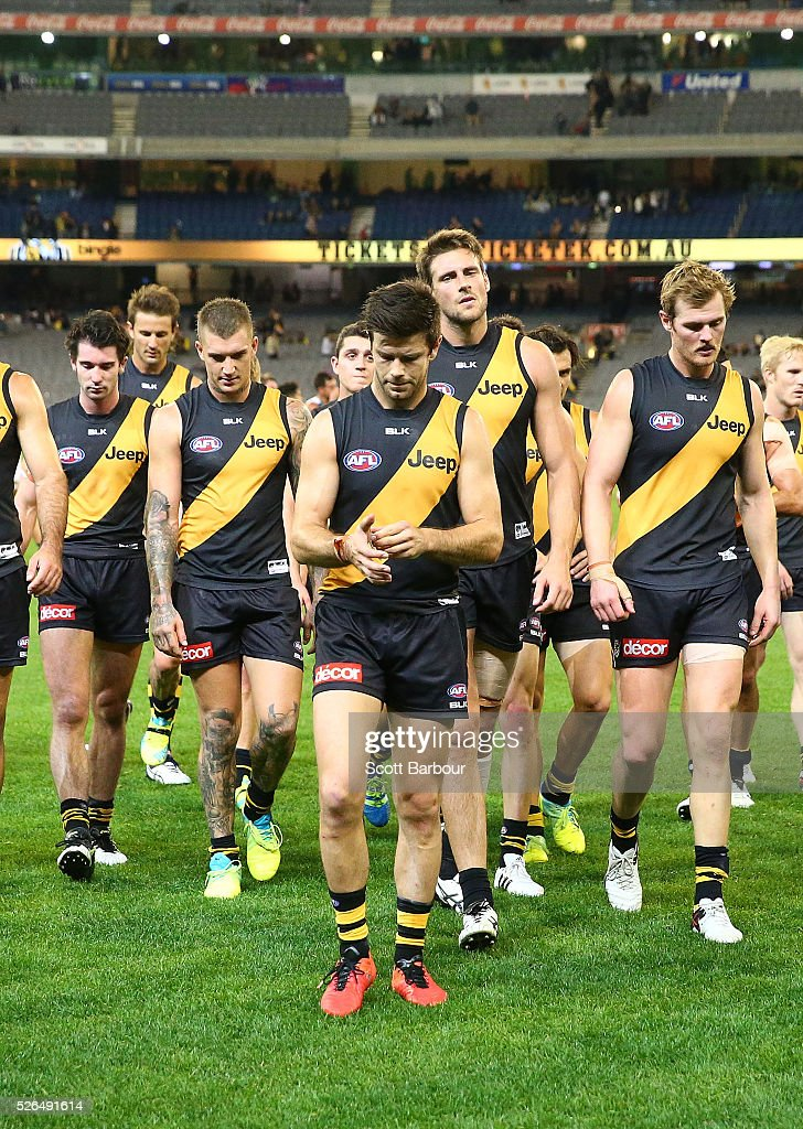 Trent Cotchin and the Tigers leave the field at full time after losing the round six AFL match between the Richmond Tigers and the Port Adelaide Power at Melbourne Cricket Ground on April 30, 2016 in Melbourne, Australia.