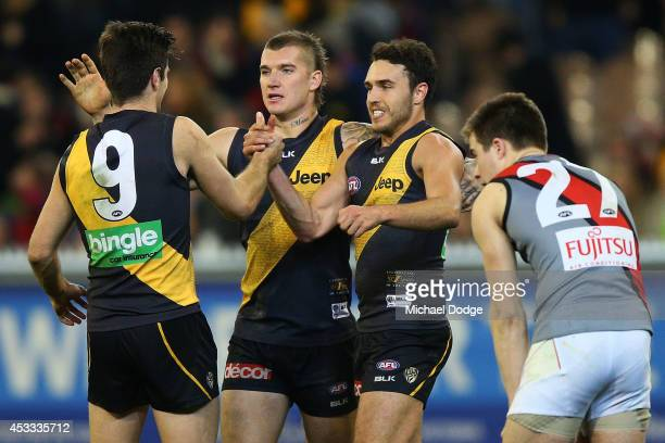Trent Cotchin Dustin Martin and Shane Edwards of the Tigers celebrate the win during the round 20 AFL match between the Richmond Tigers and the...