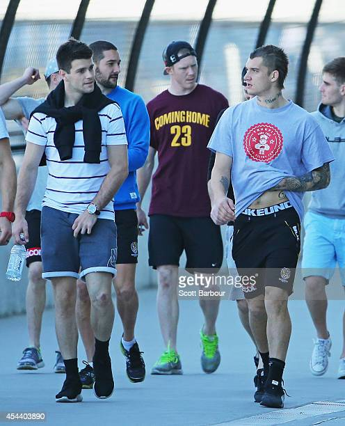 Trent Cotchin Jack Riewoldt and Dustin Martin of the Tigers talk as they walk around the MCG during a Richmond Tigers AFL recovery session on August...