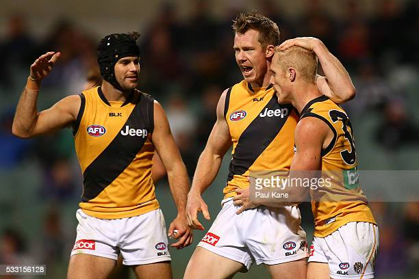 Trent Cotchin Jack Riewoldt celebrate a goal by Steven Morris of the Tigers during the round nine AFL match between the Fremantle Dockers and the...