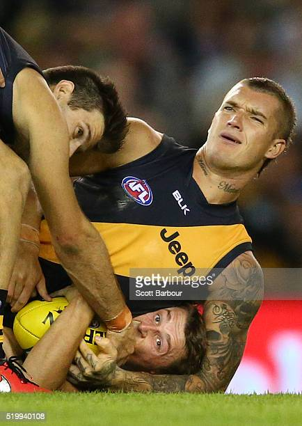 Trent Cotchin of the Richmond Tigers and Dustin Martin of the Richmond Tigers tackle Matt Crouch of the Adelaide Crows during the round three AFL...