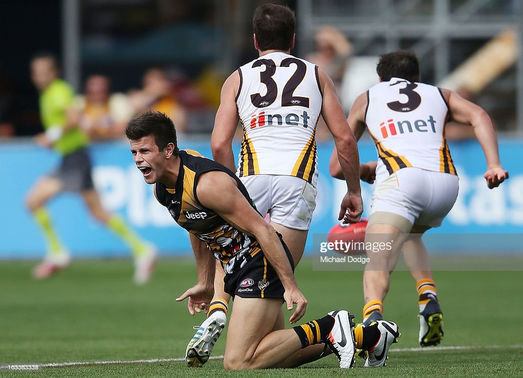 Trent Cotchin of the Richmond Tigers reacts at the umpire after being puched in the back during the round three NAB Cup AFL match between the Hawthorn Hawks and the Richmond Tigers at Aurora Stadium on March 9, 2013 in Launceston, Australia.