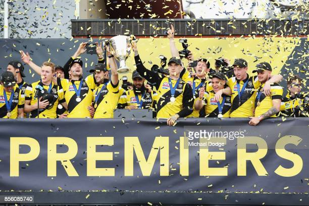 Trent Cotchin of the Tigers and Dustin Martin lift up the Premiership cup as players celebrate winning yesterday's AFL Grand Final at Punt Road Oval...