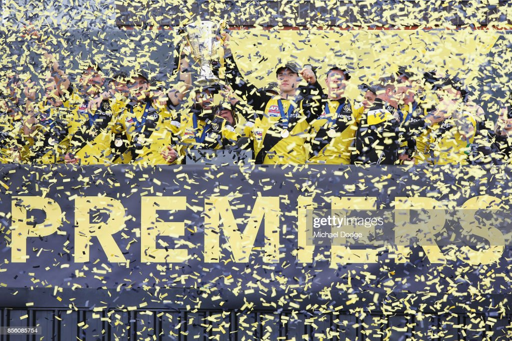 Trent Cotchin of the Tigers and Dustin Martin lift up the Premiership cup as players celebrate winning yesterday's AFL Grand Final, at Punt Road Oval on October 1, 2017 in Melbourne, Australia.