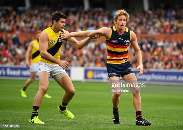 Trent Cotchin of the Tigers and Rory Sloane of the Crows compete for the ball during the round six AFL match between the Adelaide Crows and the...