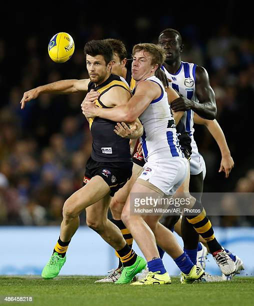 Trent Cotchin of the Tigers and Trent Dumont of the Kangaroos in action during the 2015 AFL round 23 match between the Richmond Tigers and the North...