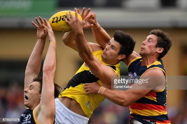 Trent Cotchin of the Tigers attempts a mark during the round six AFL match between the Adelaide Crows and the Richmond Tigers at Adelaide Oval on...