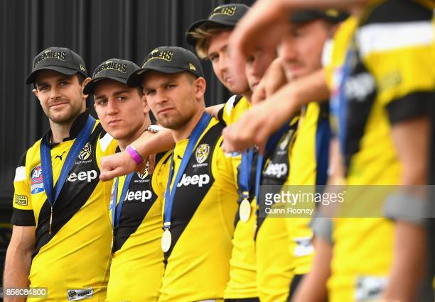 Trent Cotchin of the Tigers celebrate on stage with team mates after winning yesterday's AFL Grand Final at Punt Road Oval on October 1 2017 in...