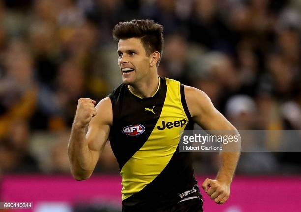 Trent Cotchin of the Tigers celebrates after scoring a goal during the round two AFL match between the Richmond Tigers and the Collingwood Magpies at...