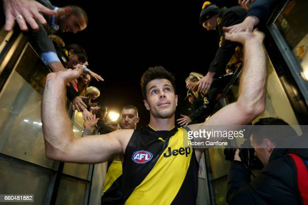 Trent Cotchin of the Tigers celebrates after the Tigers defeated the Magpies during the round two AFL match between the Richmond Tigers and the...