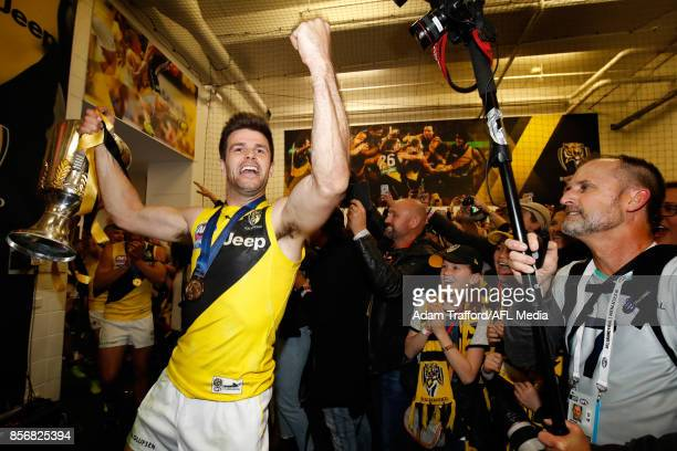 Trent Cotchin of the Tigers celebrates in the rooms with the premiership cup during the 2017 Toyota AFL Grand Final match between the Adelaide Crows...