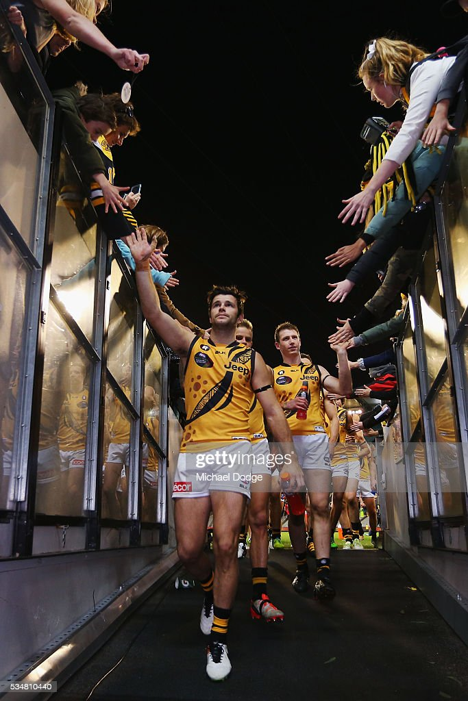 Trent Cotchin of the Tigers celebrates the win during the round 10 AFL match between the Essendon Bombers and the Richmond Tigers at Melbourne Cricket Ground on May 28, 2016 in Melbourne, Australia.