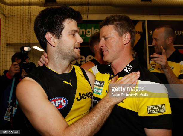 Trent Cotchin of the Tigers celebrates with Damien Hardwick Senior Coach of the Tigers during the 2017 AFL Second Preliminary Final match between the...