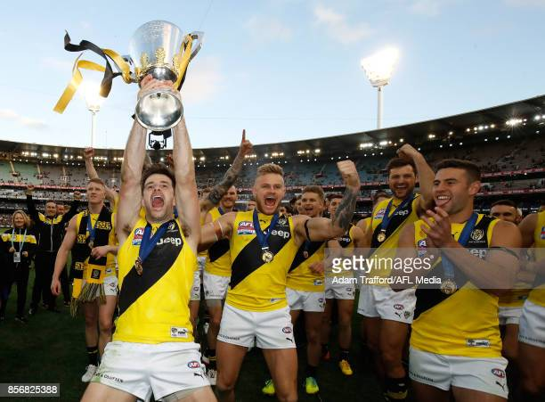 Trent Cotchin of the Tigers comes off the field with the premiership cup during the 2017 Toyota AFL Grand Final match between the Adelaide Crows and...