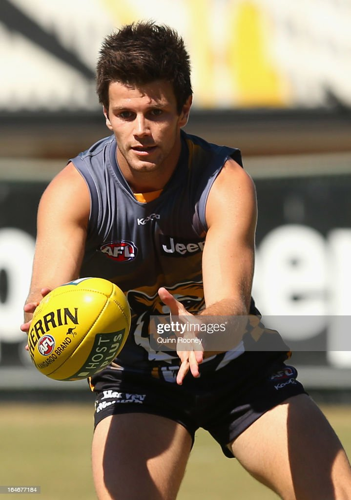 Trent Cotchin of the Tigers gathers the ball during a Richmond Tigers AFL training session at ME Bank Centre on March 26, 2013 in Melbourne, Australia.