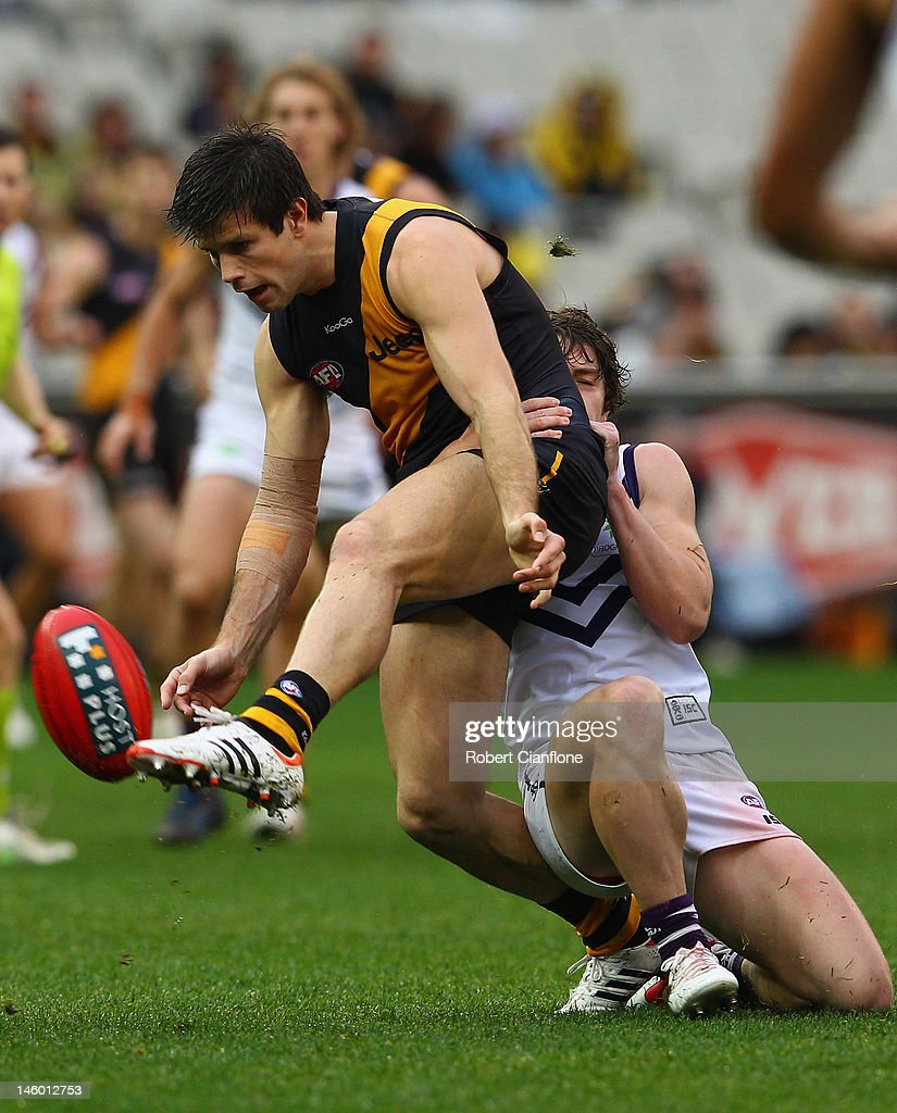 Trent Cotchin of the Tigers gets his kick away during the round 11 AFL match between the Richmond Tigers and the Fremantle Dockers at Melbourne Cricket Ground on June 9, 2012 in Melbourne, Australia.