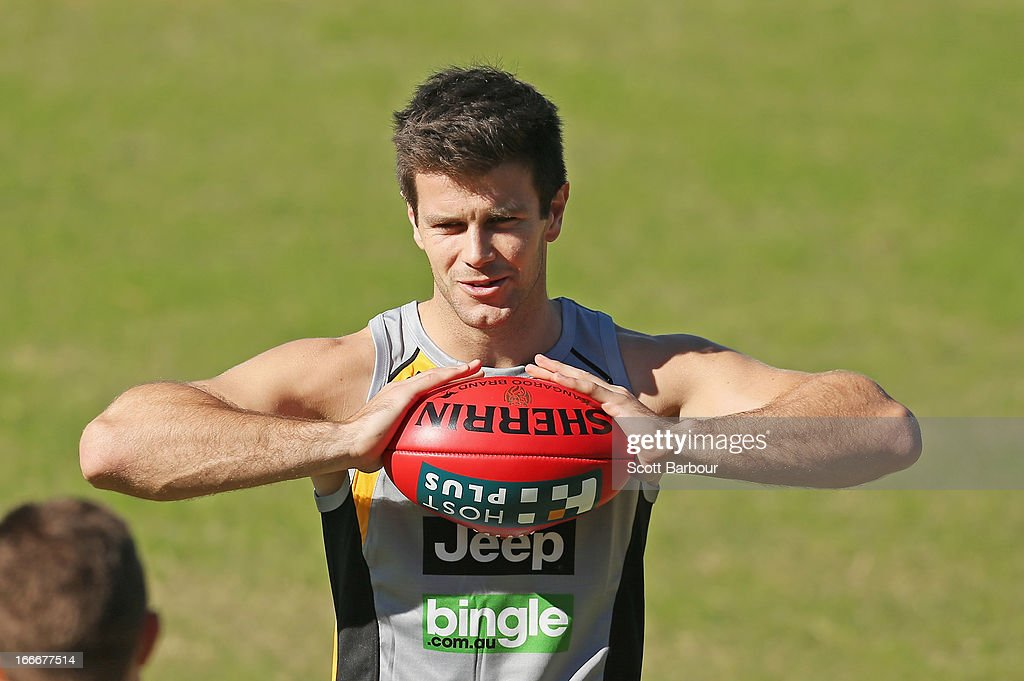 Trent Cotchin of the Tigers holds the ball during a Richmond Tigers AFL training session at ME Bank Centre on April 16, 2013 in Melbourne, Australia.