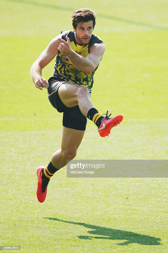 Trent Cotchin of the Tigers kicks the ball during the Richmond Tigers AFL intra-club match at Punt Road Oval on February 12, 2016 in Melbourne, Australia.