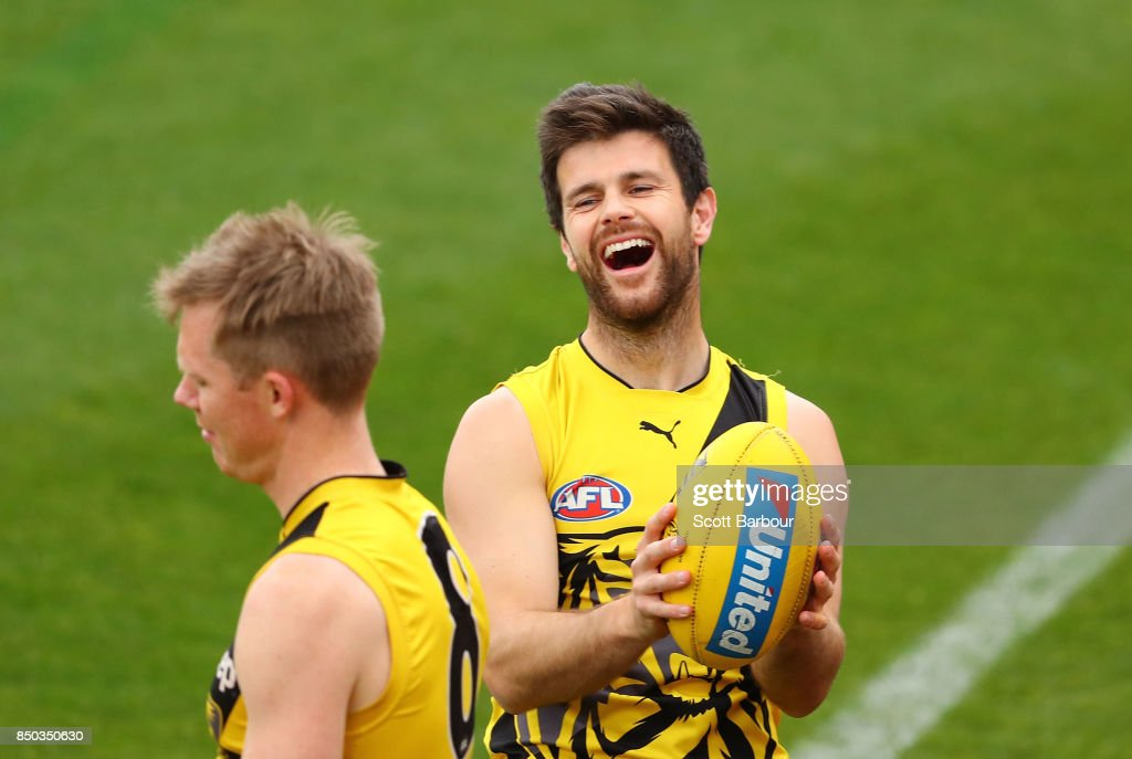 Trent Cotchin of the Tigers laughs after accidentally hitting Jack Riewoldt of the Tigers during a Richmond Tigers AFL training session at Punt Road Oval on September 21, 2017 in Melbourne, Australia.