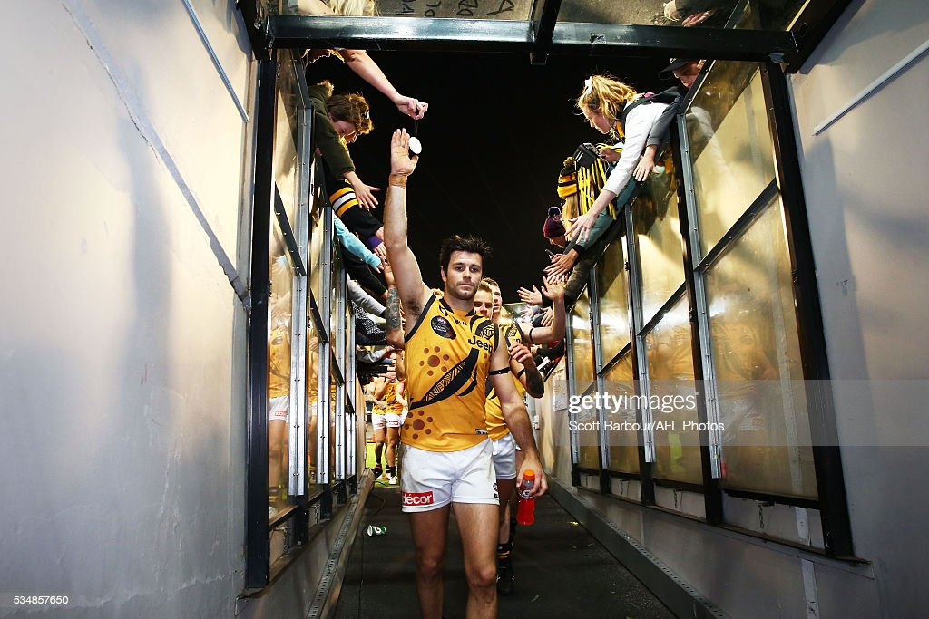Trent Cotchin of the Tigers leads his side from the field after winning the round 10 AFL match between the Essendon Bombers and the Richmond Tigers at Melbourne Cricket Ground on May 28, 2016 in Melbourne, Australia.