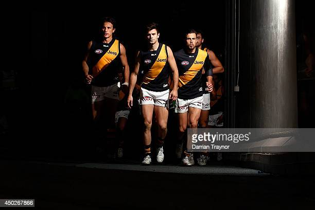 Trent Cotchin of the Tigers leads his team out after the half time break during the round 12 AFL match between the North Melbourne Kangaroos and the...