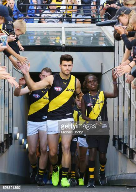 Trent Cotchin of the Tigers leads the team out during the round one AFL match between the Carlton Blues and the Richmond Tigers at Melbourne Cricket...