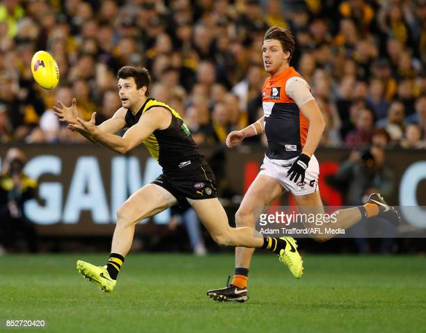 Trent Cotchin of the Tigers marks the ball ahead of Aidan Corr of the Giants during the 2017 AFL Second Preliminary Final match between the Richmond...