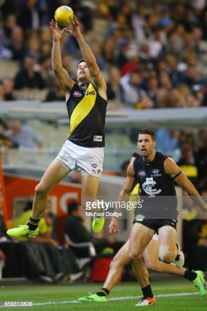 Trent Cotchin of the Tigers marks the ball during the round one AFL match between the Carlton Blues and the Richmond Tigers at Melbourne Cricket...