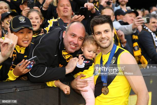 Trent Cotchin of the Tigers poses with his daughter and fans during the 2017 AFL Grand Final match between the Adelaide Crows and the Richmond Tigers...