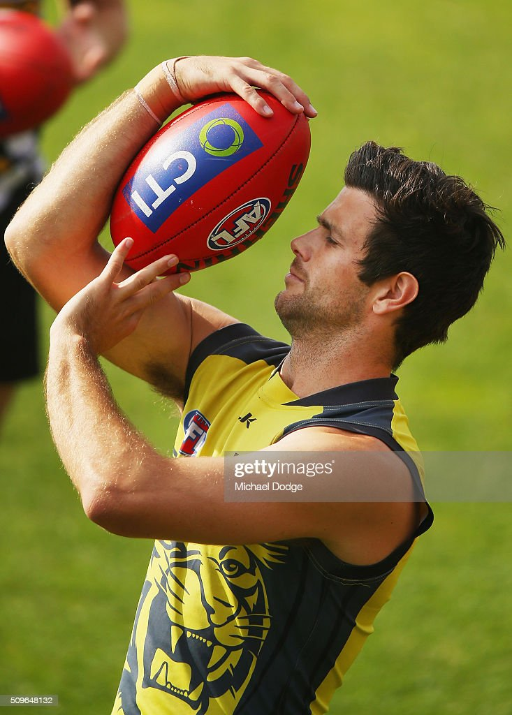 Trent Cotchin of the Tigers practices a boundary umpire throw in during the Richmond Tigers AFL intra-club match at Punt Road Oval on February 12, 2016 in Melbourne, Australia.
