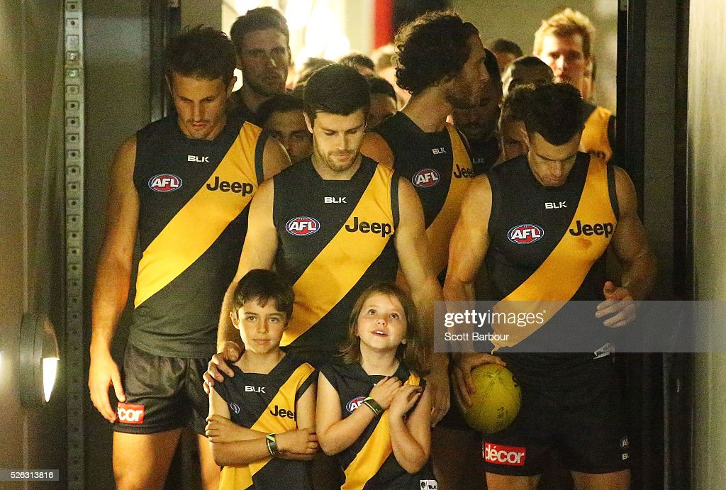 Trent Cotchin of the Tigers prepares to lead his side onto the field during the round six AFL match between the Richmond Tigers and the Port Adelaide Power at Melbourne Cricket Ground on April 30, 2016 in Melbourne, Australia.