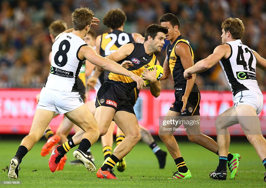 Trent Cotchin of the Tigers runs with the ball during the round six AFL match between the Richmond Tigers and the Port Adelaide Power at Melbourne Cricket Ground on April 30, 2016 in Melbourne, Australia.