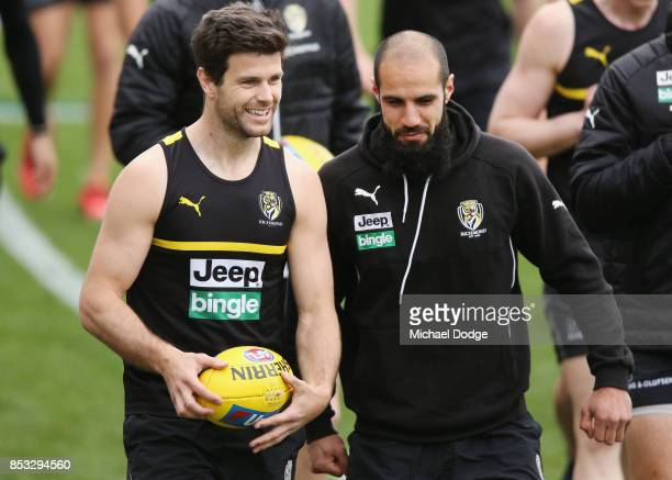 Trent Cotchin of the Tigers talks with Bachar Houli during a Richmond Tigers AFL media oportunity at Punt Road Oval on September 25 2017 in Melbourne...