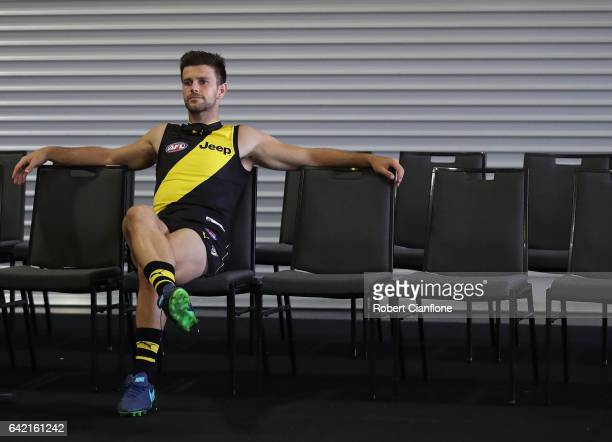 Trent Cotchin of the Tigers waits for his team mates during the Richmond Tigers AFL Team Photo Day on February 17 2017 at Punt Road Oval in Melbourne...