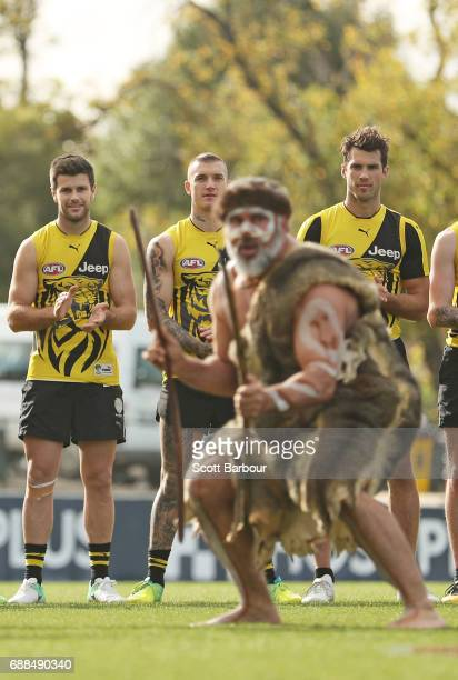 Trent CotchinDustin Martin and Alex Rance of the Tigers look on as participants of the club's Korin Gamadji Institute perform a preview of the Tigers...
