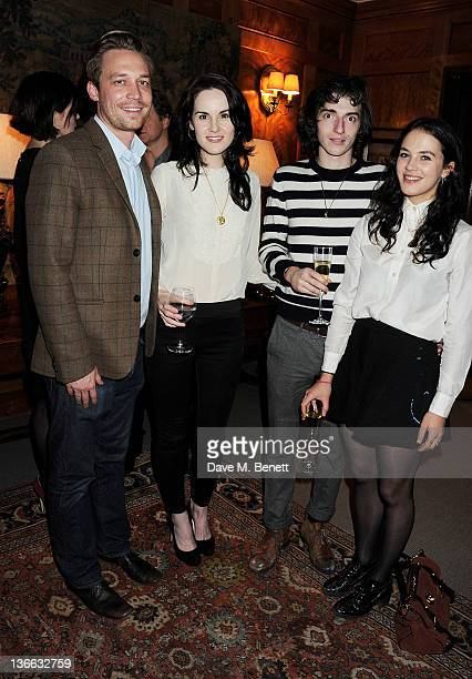 Trent Davies Michelle Dockery Thomas Campbell and Jessica Brown Findlay attend a special screening of 'My Week With Marilyn' hosted by Colin Firth at...