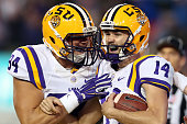 Trent Domingue of the LSU Tigers celebrates after scoring a touchdown on a fake field goal against the Florida Gators at Tiger Stadium on October 17...